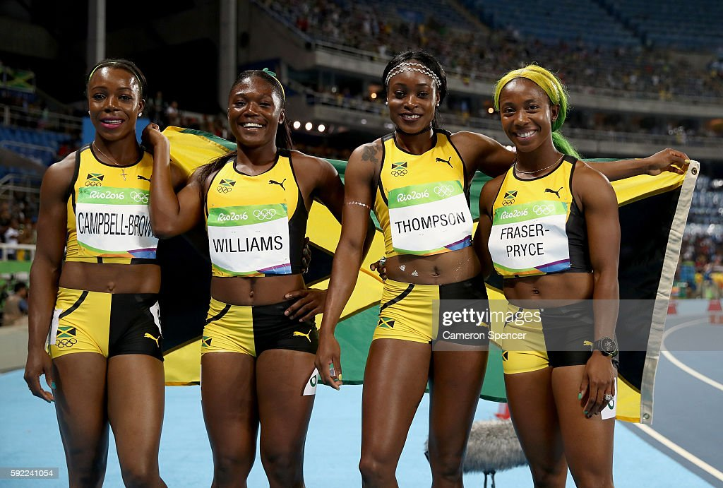 Christania Williams, Elaine Thompson, Veronica Campbell-Brown and Shelly-Ann Fraser-Pryce of Jamaica celebrate winning silver in the Women's 4 x 100m Relay Final on Day 14 of the Rio 2016 Olympic Games at the Olympic Stadium on August 19, 2016 in Rio de Janeiro, Brazil.