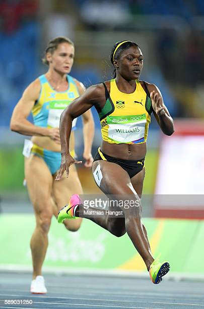 Christania Williams of Jamaica lead the Women's 100m Round 1 on Day 7 of the Rio 2016 Olympic Games at the Olympic Stadium on August 12 2016 in Rio...