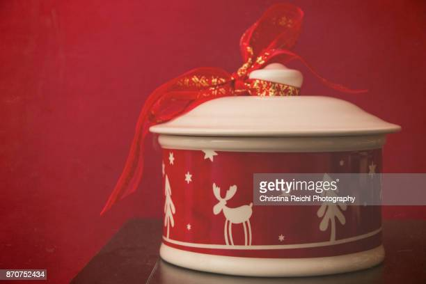 Christas themed cookie jar against red background with textures