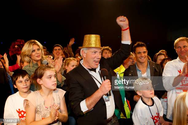 Christchurch Mayor Bob Parker celebrates with Rachel Hunter and Dan Carter during the Rise Up Christchurch telethon appeal event at CBS Canterbury...