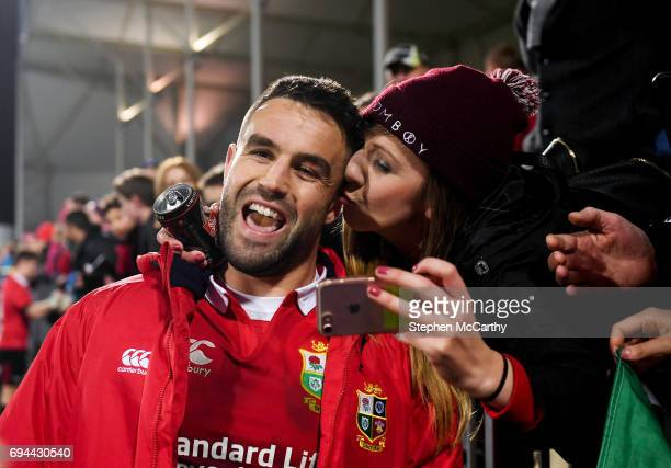 Christchurch New Zealand 10 June 2017 A supporter sneaks a kiss on Conor Murray of the British Irish Lions following the match between Crusaders and...