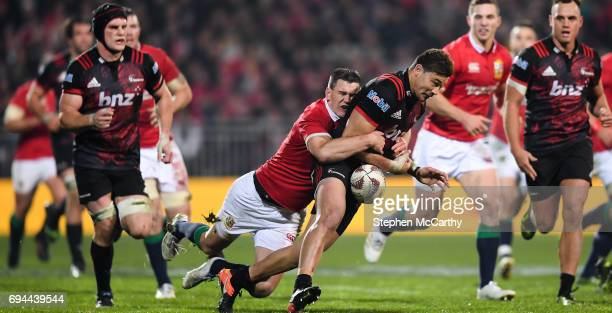 Christchurch New Zealand 10 June 2017 David Havili of Crusaders is tackled by Jonathan Sexton of the British Irish Lions during the match between...