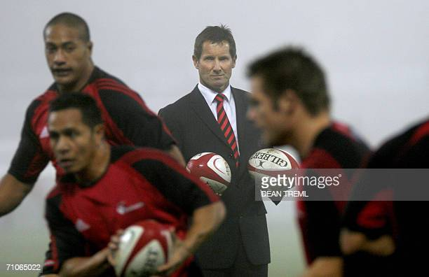Crusaders coach Robbie Deans watches his players warm up prior to the Super 14 final between the Crusaders and the Hurricanes played in foggy...