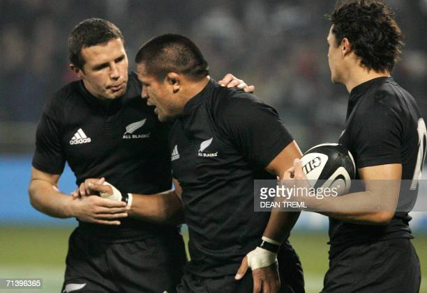 Double try scorer Keven Mealamu of New Zealand's All Blacks is congratulated by teammates Aaron Mauger and Dan Carter during the opening of the...