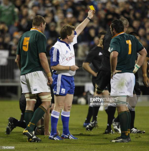 Referee Stuart Dickinson sends off South African Springboks player Pedrie Wannenburg during the triNations rugby Test at the Jade Stadium in...