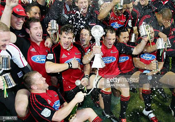 The Crusaders celebrate with the winners trophy after their Super 14 final against the Hurricanes which was played in foggy conditions at Lancaster...