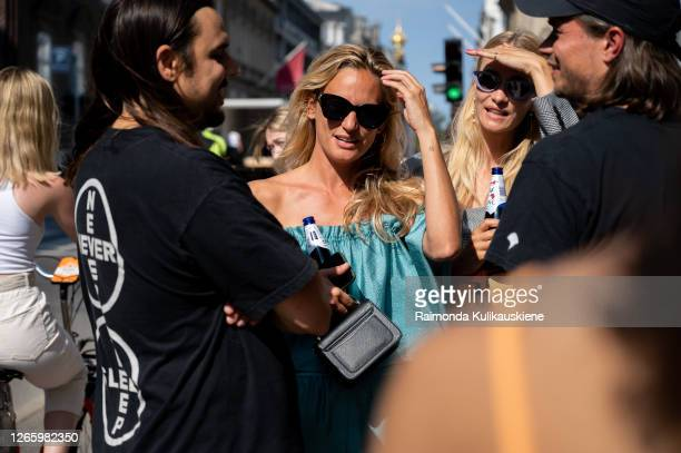 Christel Winther outside MFPEN wearing Stine Goya electric green shorts and matching top during Copenhagen fashion week SS21 on August 12 2020 in...