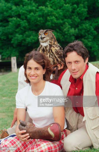 Christelle Ballestrero and Antoine de Maximy cohosts of Animal Zone sit with an owl