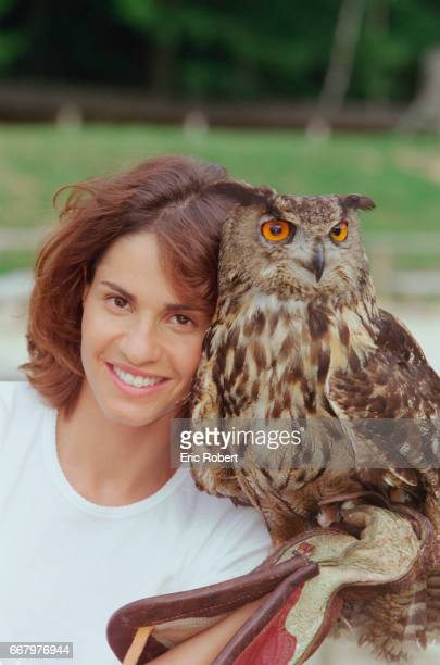 Christelle Ballestrero cohost of Animal Zone with Antoine de Maximy poses with an owl