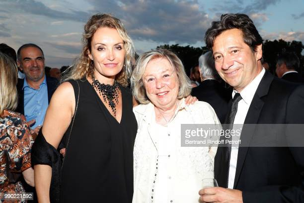 Christelle Bardet, Maryvonne Pinault and Laurent Gerra attend Line Renaud's 90th Anniversary on July 2, 2018 in Paris, France.