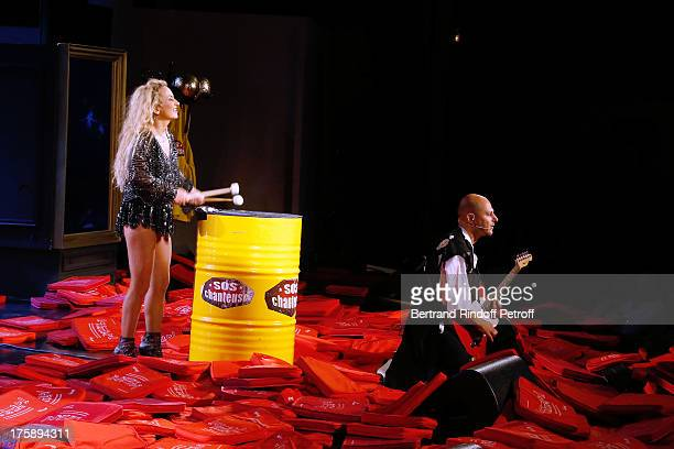 Christelle Chollet and musician Raphael Alazraki perform after the traditional throw of cushions at the final of Christelle Chollet one woman show...