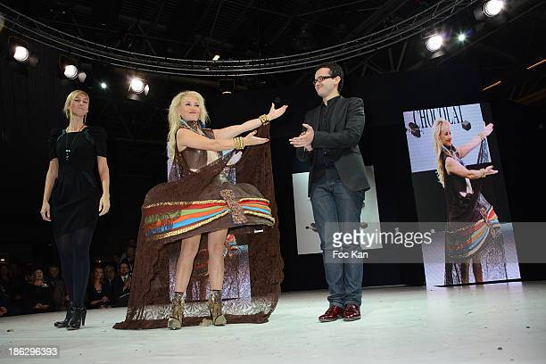 Christelle Chollet dressed by Wanderson Alves de Melo and chef from Cemoi attend the Salon Du Chocolat 2014 Fashion Chocolate Show at Parc des...