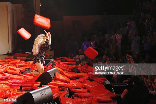 Christelle Chollet performs after the traditional throw of cushions at the final of her one woman show The New Show written and set stage by Remy...