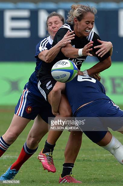 Christelle le Duff and Fanny Horta of France tackle Kayla McAlister of New Zealand during their semi final match of the IRB Women's Sevens World...