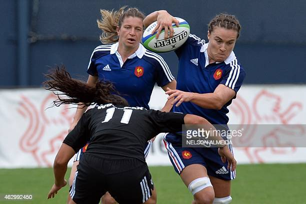 Christelle Le Duff of France runs past a tackle from Portia Woodman of New Zealand during their semi final match of the IRB Women's Sevens World...