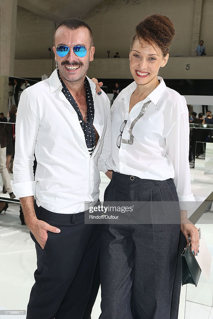 Christelle Saint Louis (R) and guest attend Dior Homme Menswear Spring/Summer 2014 Show As Part Of The Paris Fashion Week on June 29, 2013 in Paris, France.