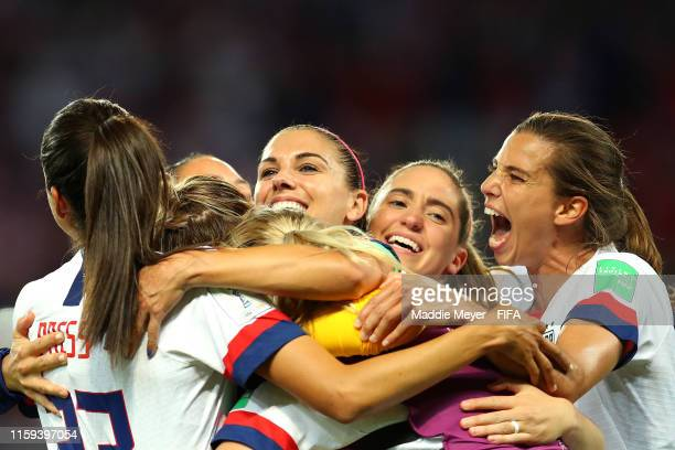 Christen Press Alex Morgan Morgan Brian and Tobin Heath celebrate after the 2019 FIFA Women's World Cup France Quarter Final match between France and...