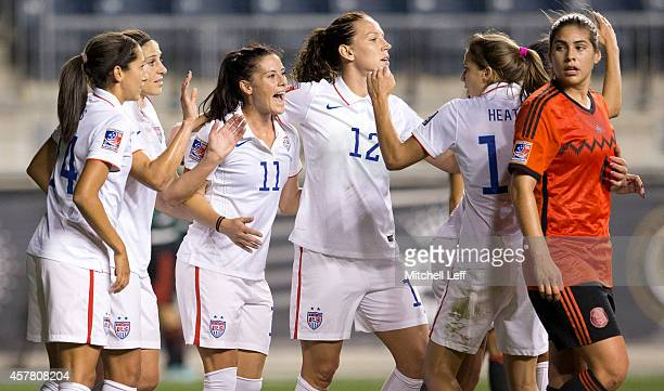 Christen Press Carli Lloyd Ali Krieger Lauren Holiday and Tobin Heath of the United States react after Lloyd scored on a penalty kick in the first...
