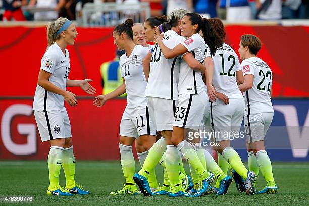 Christen Press celebrates with Abby Wambach of the United States after Press scores a second half goal against Australia during the FIFA Women's...