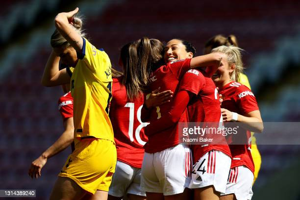 Christen Press of Manchester United celebrates with Ella Toone after scoring their side's second goal during the Barclays FA Women's Super League...