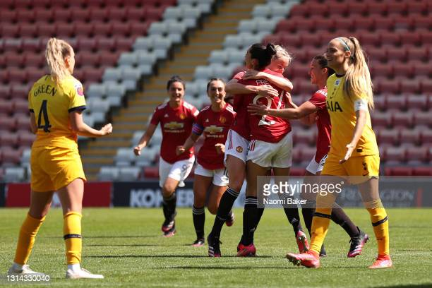 Christen Press of Manchester United celebrates with Millie Turner after scoring their side's second goal during the Barclays FA Women's Super League...