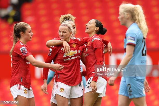 Christen Press of Manchester United celebrates with teammates Ella Toone, Jackie Groenen and Lauren James after scoring her team's second goal during...
