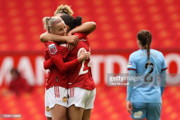 Christen Press of Manchester United celebrates with teammates Jackie Groenen and Lauren James after scoring her team's second goal during the...