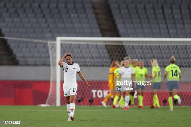 Christen Press of Team United States looks dejected after their side concede a third goal scored by Lina Hurtig of Team Sweden during the Women's...