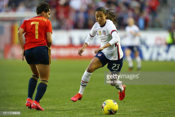 Christen Press of the United States carries the ball against Marta Corredera of Spain at Red Bull Arena on March 08 2020 in Harrison New Jersey