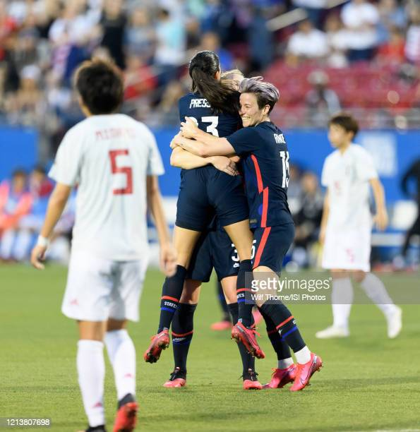 Christen Press of the United States celebrates her goal with Samantha Mewis and Megan Rapinoe during a game between Japan and USWNT at Toyota Stadium...