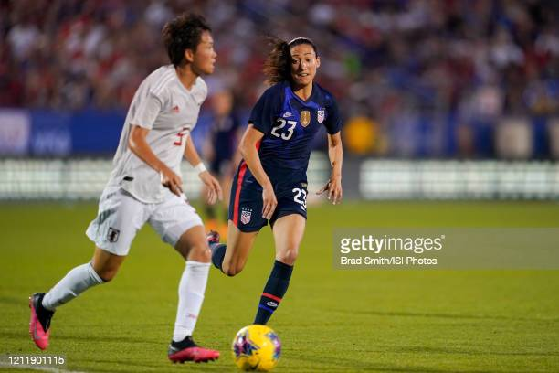 Christen Press of the United States chases after Moeka Minami of Japan during a game between Japan and USWNT at Toyota Stadium on March 11 2020 in...