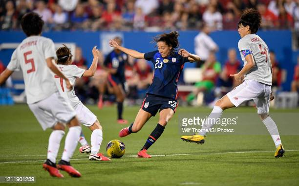 Christen Press of the United States chips in a goal during a game between Japan and USWNT at Toyota Stadium on March 11 2020 in Frisco Texas