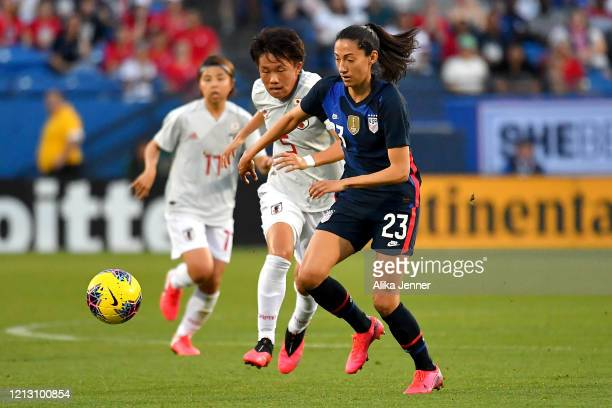 Christen Press of the United States controls the ball gainst Moeka Minami of Japan during the first half of the SheBelieves Cup match at Toyota...