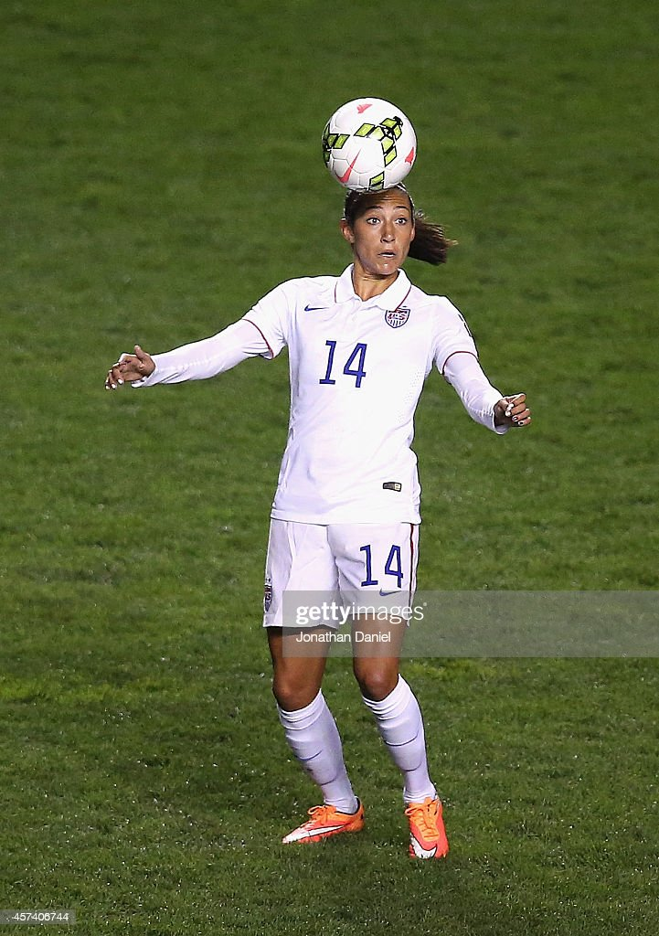 Christen Press #14 of the United States heads the ball against Guatemala during the 2014 CONCACAF Women's Championship at Toyota Park on October 17, 2014 in Bridgeview, Illinois. The United States defeated Guatemala 5-0.