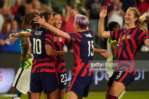 Christen Press of the United States is congratulated by teammates Carli Lloyd, Megan Rapinoe and Samantha Mewis after scoring a goal against Nigeria...