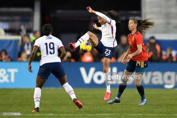 Christen Press of the United States kicks the ball as Virginia Torrecilla of Spain defends during the second half in the SheBelieves Cup at Red Bull...