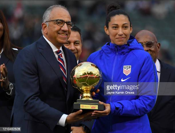 Christen Press of the United States receives the Scotiabank Golden Ball Award from Carlos Cordeiro president of US Soccer after the CONCACAF Women's...