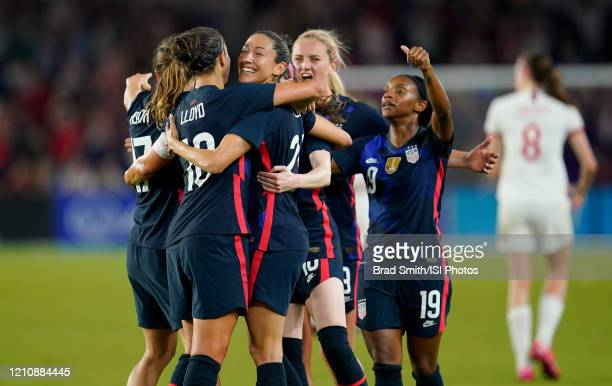 Christen Press of the United States scores a goal and celebrates with Tobin Heath Carli Lloyd Lindsey Horan Crystal Dunn and the USWNT during a game...