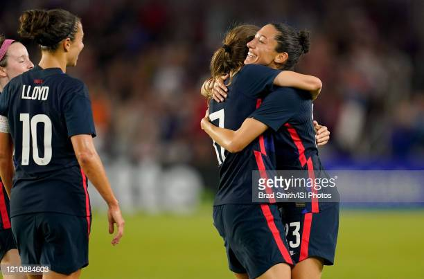 Christen Press of the United States scores a goal and celebrates with Tobin Heath during a game between England and USWNT at Exploria Stadium on...