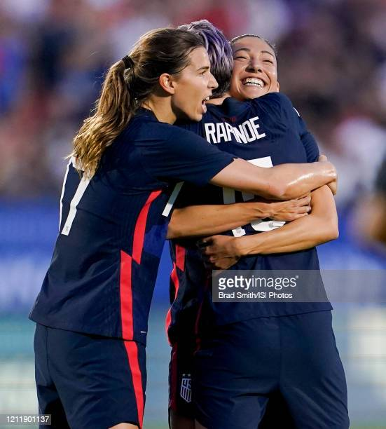 Christen Press of the United States scores a goal and celebrates with Megan Rapinoe and Tobin Heath during a game between Japan and USWNT at Toyota...
