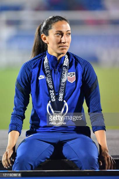 Christen Press of the United States sits on the championship stage after defeating Japan 31 in the SheBelieves Cup at Toyota Stadium on March 11 2020...