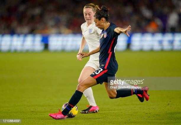 Christen Press of the United States takes a shot on goal during a game between England and USWNT at Exploria Stadium on March 05 2020 in Orlando...