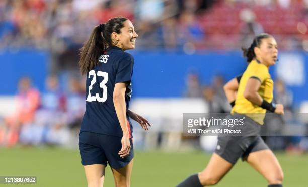 Christen Press of the United States watches her kick go in the goal making it 20 over Japan in the first half during a game between Japan and USWNT...