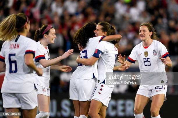 Christen Press of the U.S. Woman's national soccer team and Tobin Heath react after a goal during the second half against the Costa Rica woman's...