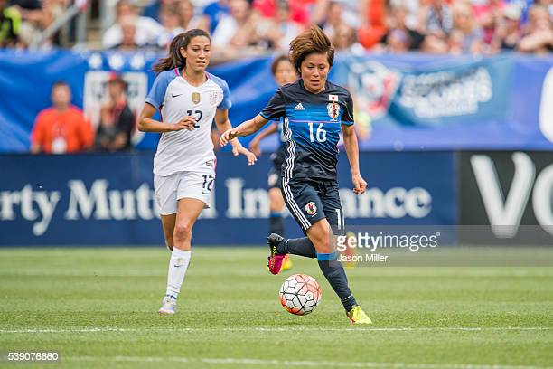 Christen Press of the US Women's National Team puts pressure on Mana Iwabuchi of Japan during the second half of a friendly match on June 5 2016 at...