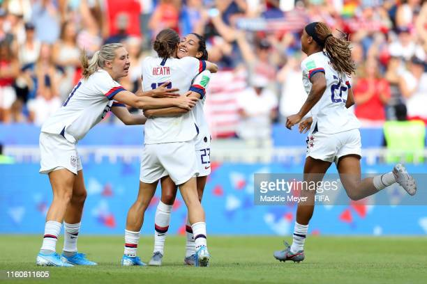 Christen Press of the USA celebrates victory with teammates Tobin Heath Allie Long and Jessica McDonald after the 2019 FIFA Women's World Cup France...