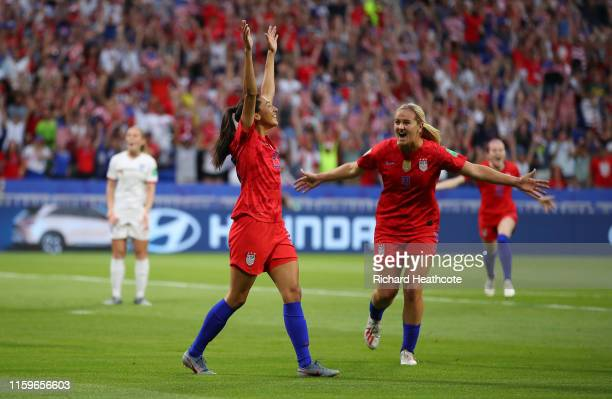 Christen Press of the USA celebrates with teammate Lindsey Horan after scoring her team's first goal during the 2019 FIFA Women's World Cup France...