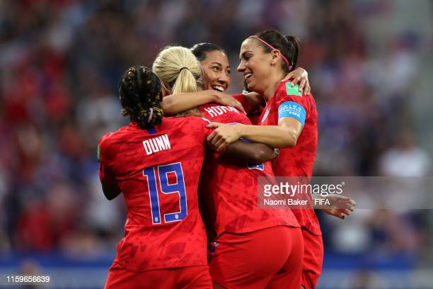 Christen Press of the USA celebrates with teammates after scoring her team's first goal during the 2019 FIFA Women's World Cup France Semi Final...