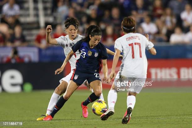 Christen Press of the USA fight the ball during a match between United States and Japan as part of 2020 SheBelieves Cup at Toyota Stadium on March 11...
