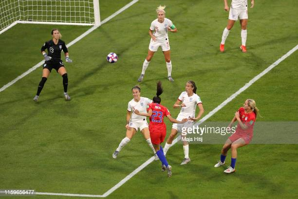 Christen Press of the USA scores her team's first goal during the 2019 FIFA Women's World Cup France Semi Final match between England and USA at...